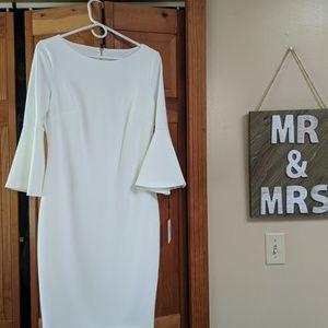 Timeless white Calvin Klein bell sleeved dress